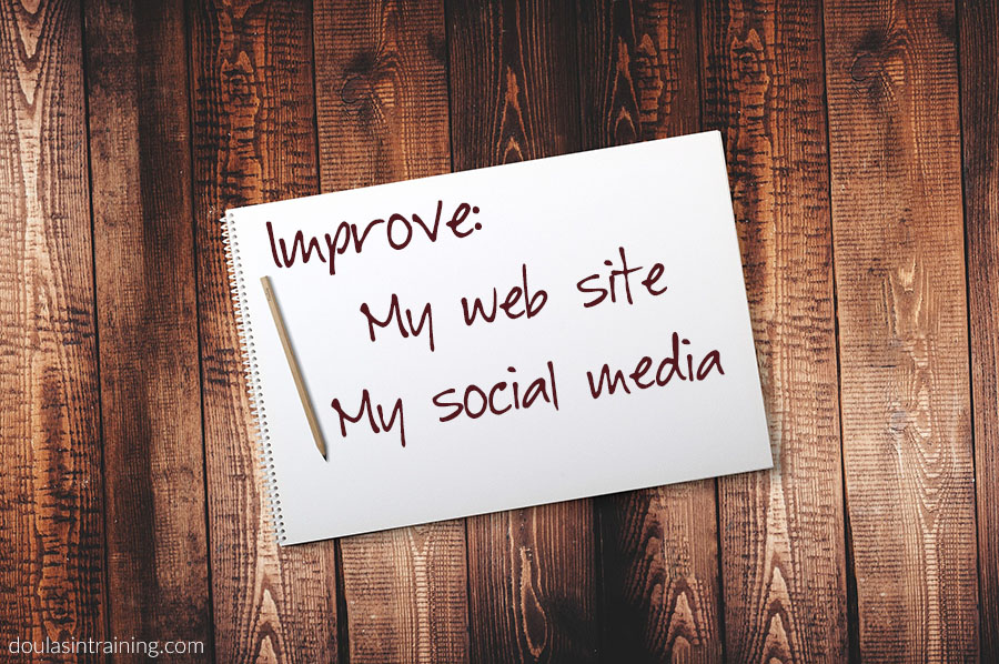 Notebook that says Improve My Web Site and Social Media
